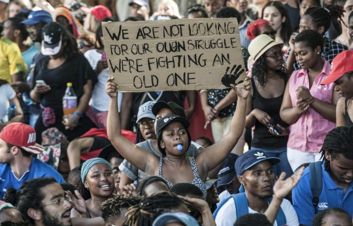 Pushing for change: Students at the University of Cape Town during the #FeesMustFall protests.