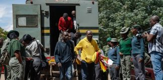 Zimbabwean cleric and activist Pastor Evan Mawarire exits a prison truck as he arrives at the Harare Magistrates Court.