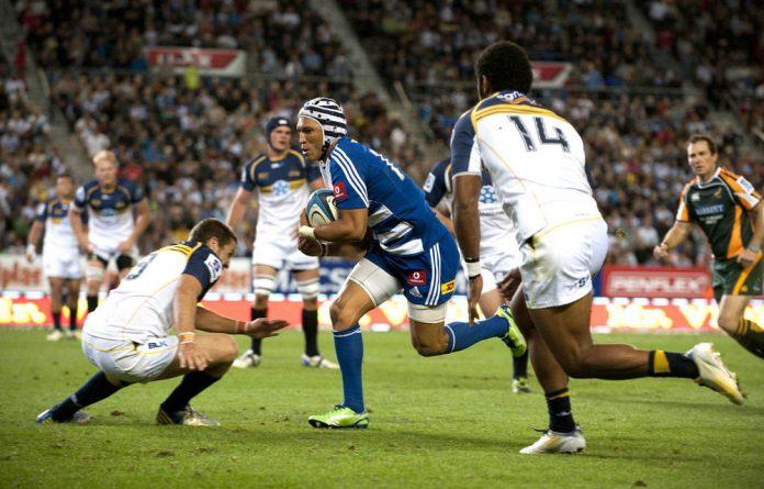 Gia Aplon of the Stormers bursting through the Brumbies defence in Cape Town.