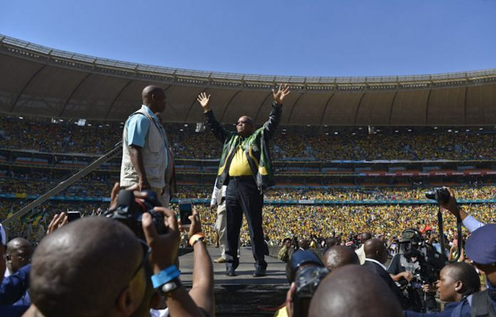 President Jacob Zuma arrives at the FNB Stadium in Soweto filled to capacity at the final ANC campaign rally.