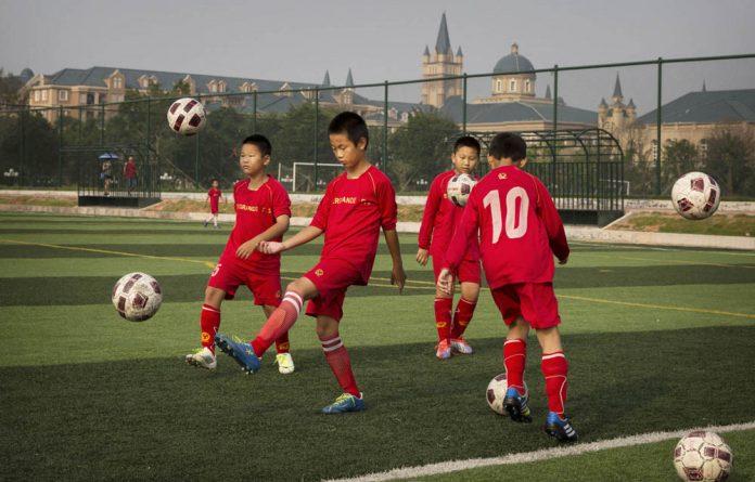 Children practice at the Evergrande football school