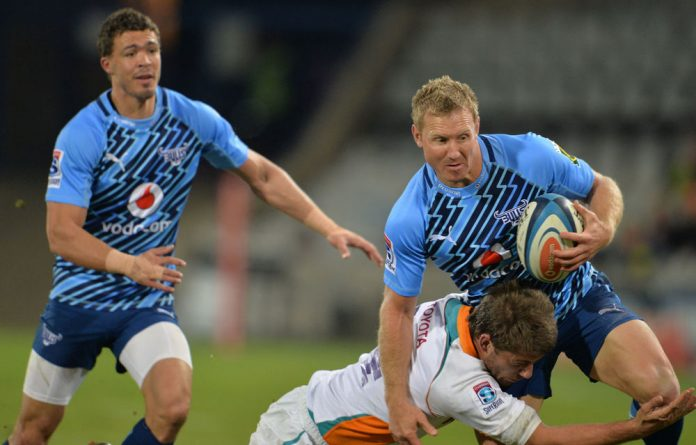 Jano Vermaak tries to shrug off a tackle against the Cheetahs in Bloemfontein on Saturday.