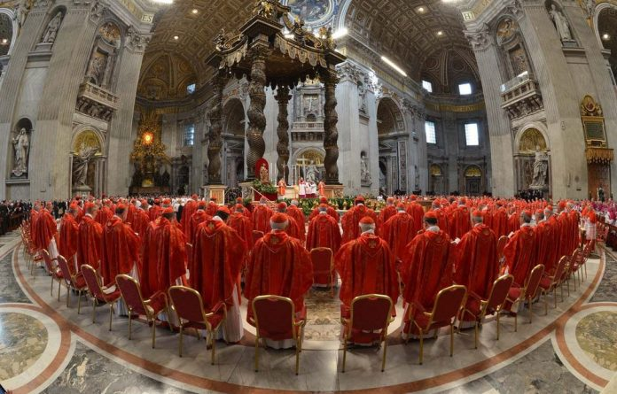 Cardinals attend a mass at the St Peter's basilica before the start of the conclave to elect the next pontiff.