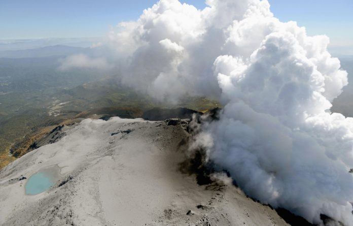 Volcanic smoke rises from Mount Ontake