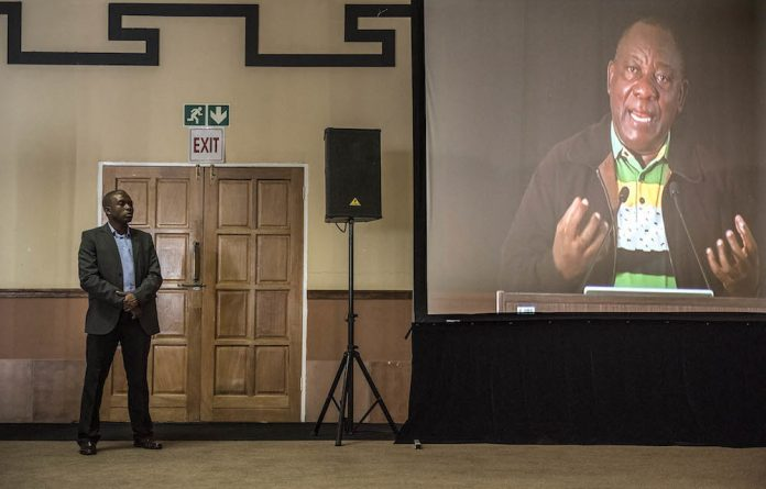 Labour's sweetheart: Cyril Ramaphosa addresses delegates at Cosatu's central committee meeting this week. Some unions want a 'backup plan' in case he doesn't become the next ANC president.