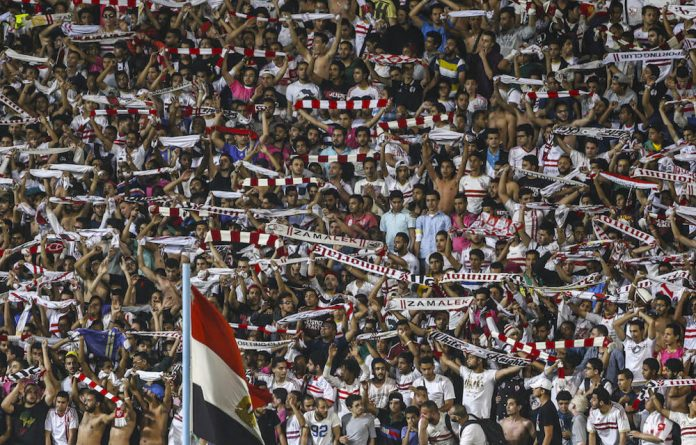 Egypt's Zamalek fans cheer before the start of the game.