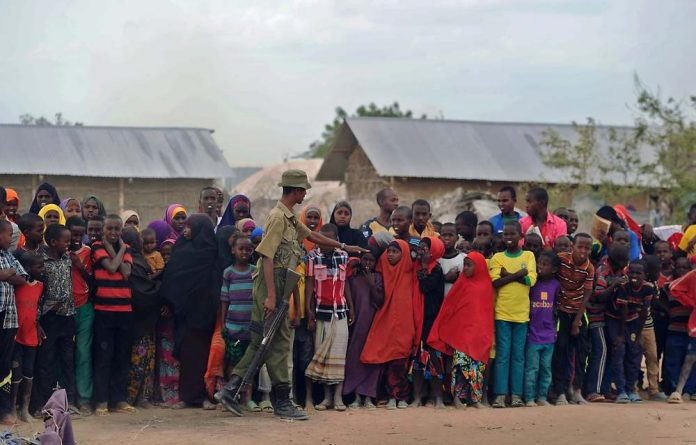 Young refugees at Kenya's sprawling Dadaab refugee complex are seen during a visit from Nobel laureate Malala Yousafzai.