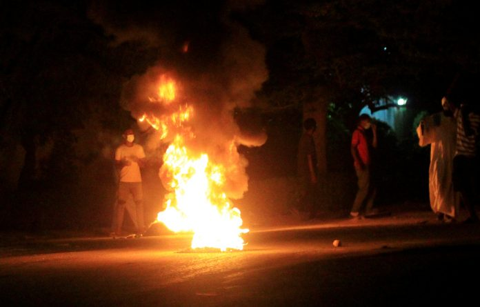 Protesters set fires in the street in Khartoum