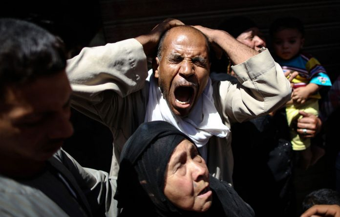 An Egyptian man reacts outside a courtroom on in Egypt's southern province of Minya after the court confirmed death sentences for 183 Islamists.
