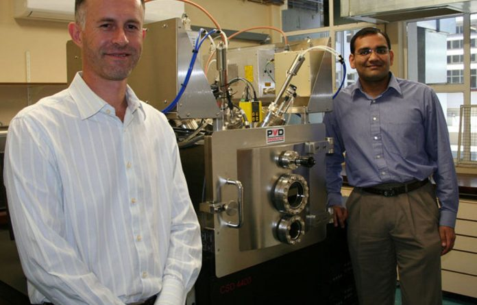 Professors Cobus Kriek of North-West University and Vijay Ramani of the Illinois Institute of Technology in Chicago at the metal vapour deposition equipment.