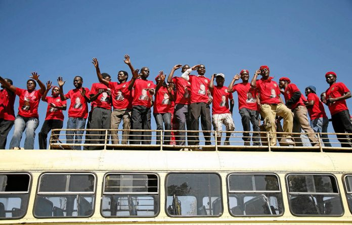 Riding high: MDC supporters arrive at Rudhaka stadium for the launch of the party's manifesto. P