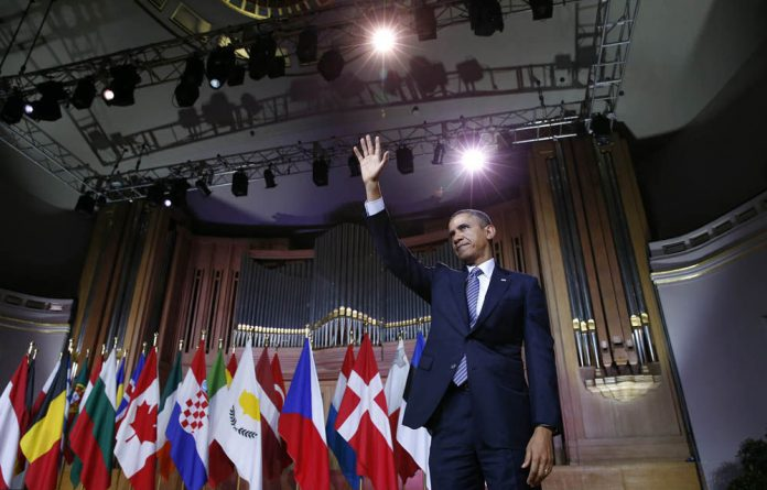 US President Barack Obama has told the Euro elite in Brussels that Russia's actions in Crimea cannot be ignored as they set an anarchic precedent.