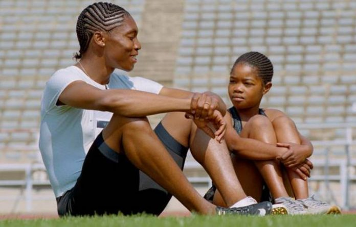 Caster Semenya alongside the young girl who plays her in the film.