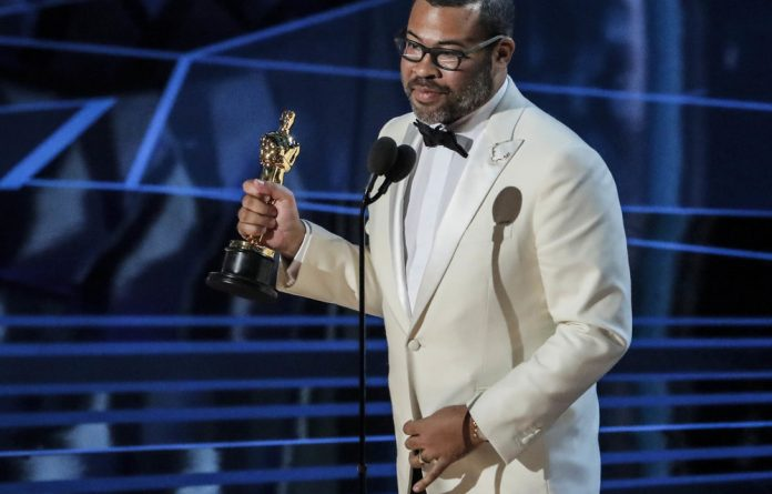Jordan Peele accepts the Oscar for Best Original Screenplay for