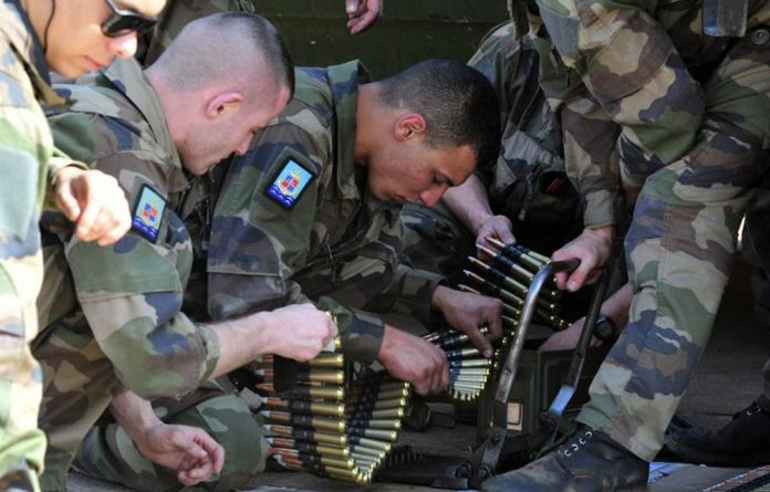 French soldiers prepare ammunition on January 16 2013 at a military airbase in Bamako.