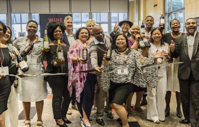 Cheers: The Treasure Chest Collective wine producers cut the ribbon at the Johannesburg launch of their 100 wine varieties.