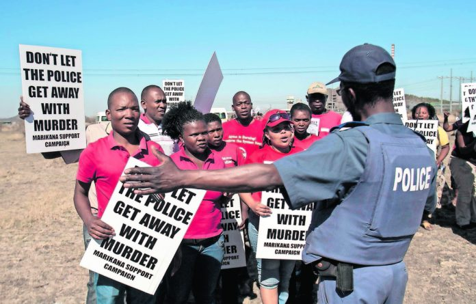 Death's hill: Protesters were present on the day the Farlam Commission of Inquiry inspected the koppie at Marikana where 34 miners shot by police. Photo: Delwyn Verasamy Picture: Delwyn Verasamy