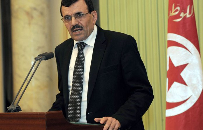 Tunisia's Prime Minister Ali Larayedh said the new government would serve until an election is held before the end of the year.