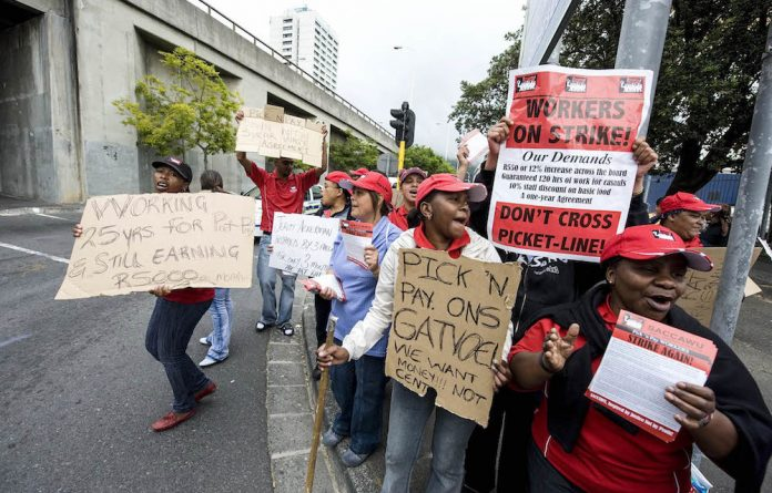 Pick 'n Pay employees on strike demonstrate outside the Gardens' store in Cape Town.