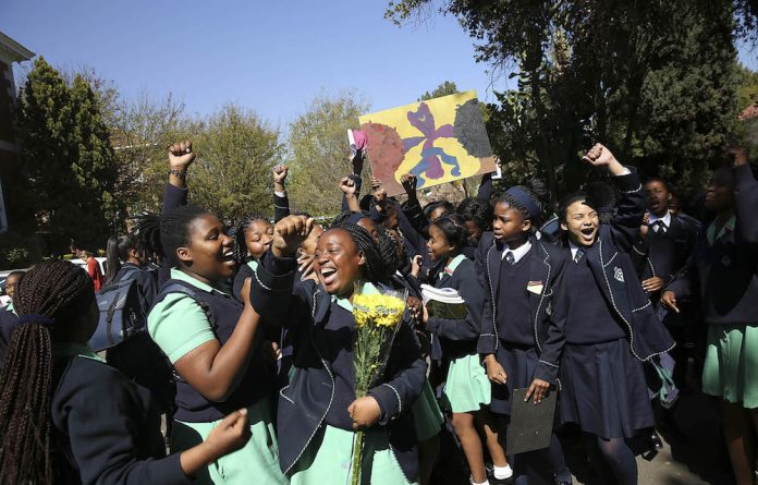 Roots of discontent: Learners protest outside the Pretoria High School for Girls against its hair policy and alleged racism.