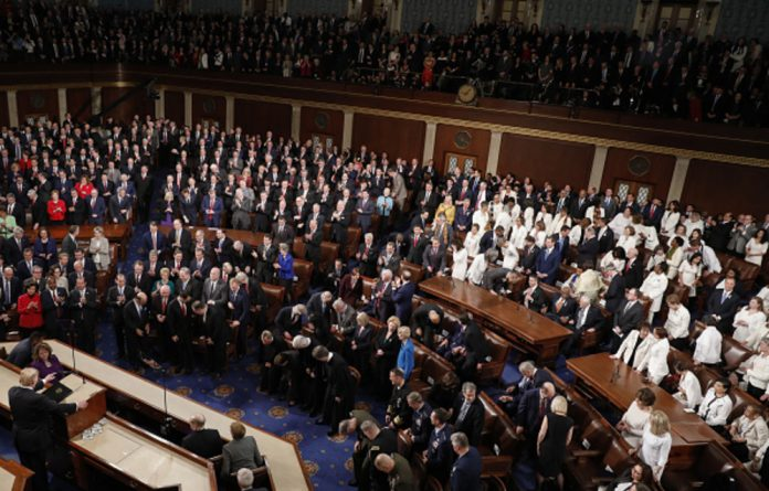 US President Donald Trump delivers a State of the Union address to a joint session of Congress at the US Capitol. Democrat lawmakers dressed in suffragette white.