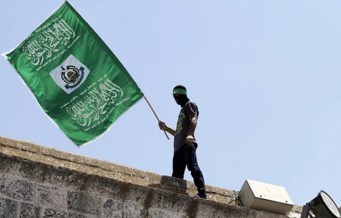 The Palestinian Islamist movement Hamas unveiled on May 1 a new policy document easing its stance on Israel after having long called for its destruction