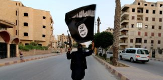 A member loyal to the Islamic State in Iraq and the Levant