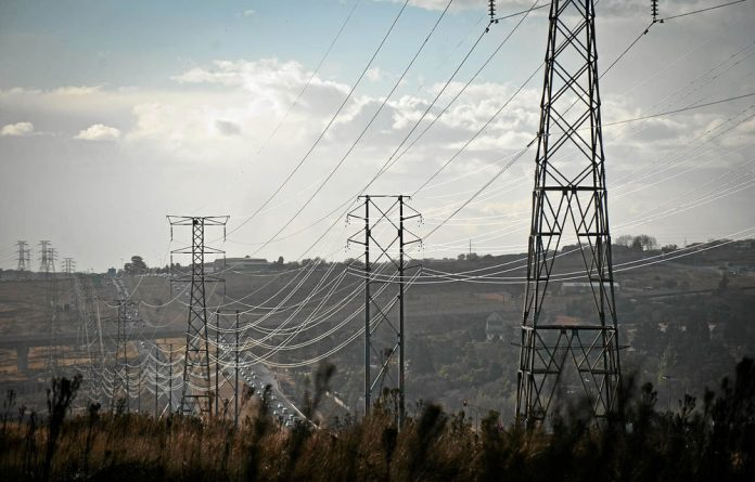Power lines in Midrand transfer electricity from fossil fuel-powered stations.