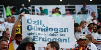 Germany fans display a banner referencing Germany's Mesut Özil and Ilkay Gundogan and Turkish President Tayyip Erdogan.