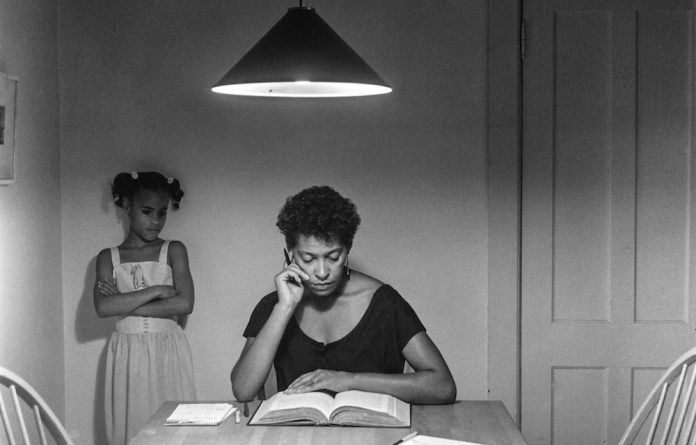 Mother and child: An image from Carrie Mae Weems' Kitchen Table Series.