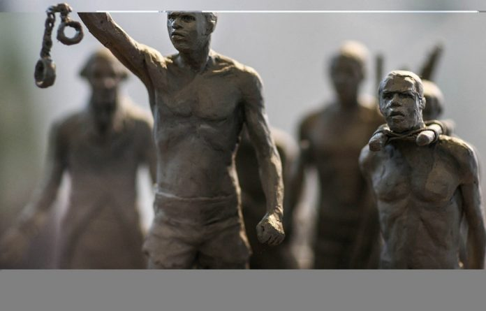 A maquette of a statue recalling enslaved Africans who died during the slave trade. The author makes the example of merging English and African literature departments as an innovative way to restructure local academia.