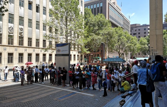Parents of unregistered students queuing outside the department of basic education