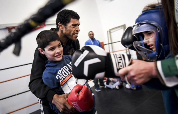 Comeback: Partially blind Jorge Pina teaches boxing to autistic children at Olivais School in Lisbon.