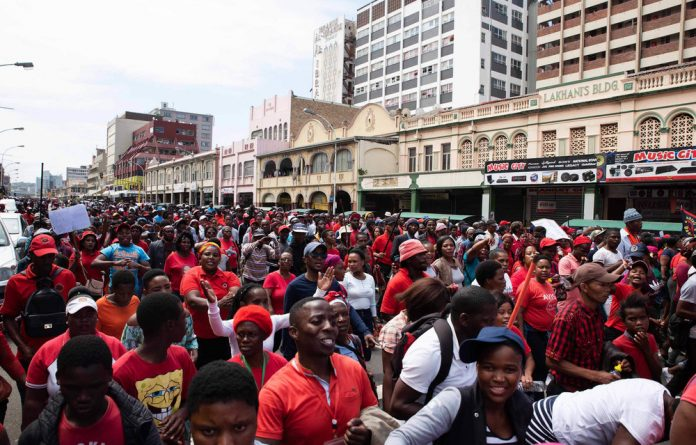 Abahlali members take to the streets under heavy police presence. Durban CBD came to a standstill on Monday as thousands of Abahlali BaseMjondolo members marched its streets protesting against political motivated killings.