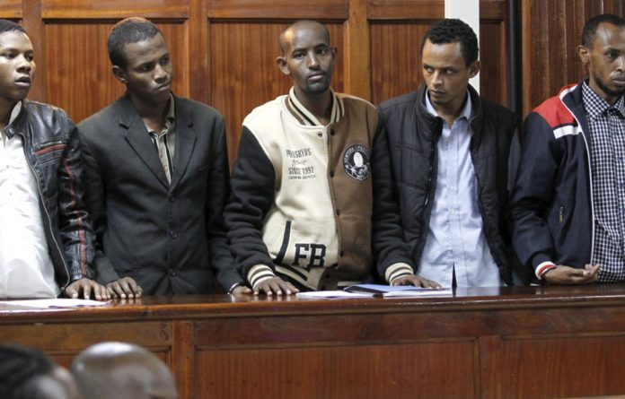 The prosecution alleges that the five suspects colluded to carry out the attack but have not said what their roles were.