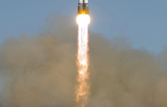 The Russian Soyuz-V carrier rocket carrying the Photon-M biological satellite blasts off from Baikonur comodrome in Kazakhstan
