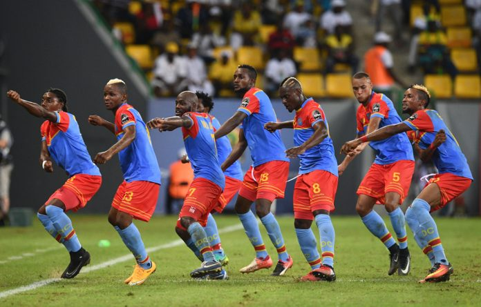 Democratic Republic of Cong players celebrate by dancing the fimbu following their third goal during the 2017 Africa Cup of Nations group C football match between Togo and DR Congo in Port-Gentil.