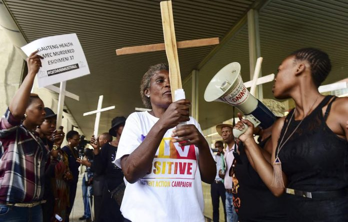 Dear ones: A vigil for patients who died after transfer from Life Esidimeni. The company and a new NGO using its facilities received provincial government money via 'conduits'.