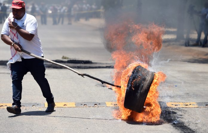 The Economic Freedom Fighters leader Julius Malema urges protesters outside the Union Buildings to stop Mantashing