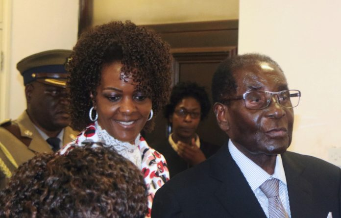 Robert Mugabe accompanied by his wife Grace Mugabe.