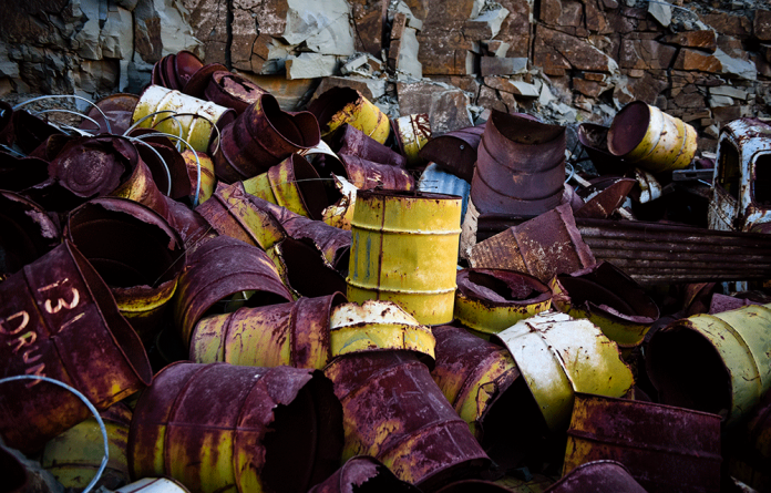 Unrehabilitated radioactive waste lies in an open pit in the Karoo.