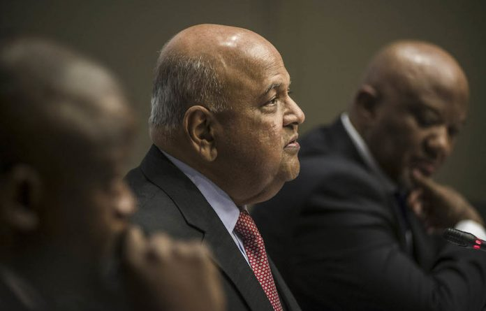 Political trap: Finance Minister Pravin Gordhan must trim costs and up social spending.