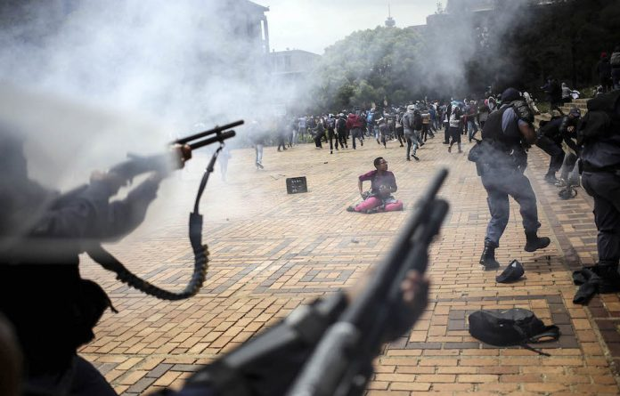 Regressive: Police at Wits University last year – a development that was resisted by the institution during apartheid. Photo: Siphiwe Sibeko/Reuters