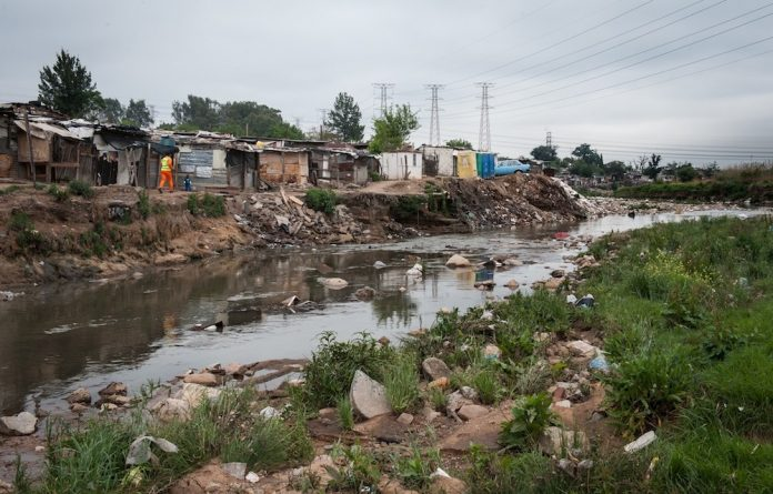 Big stink: The badly polluted Jukskei River passes Alexandra. Health concerns arise when it floods in the rainy season.