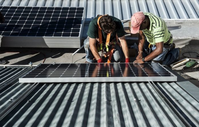 The installation of solar panels.