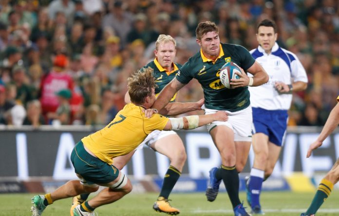 South Africa's Malcolm Marx is challenged by AustraliaÕs captain Michael Hooper.