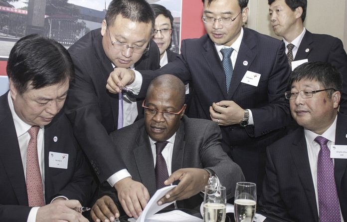 Rolling start: Then Transnet chief executive Brian Molefe signs off a deal with a Chinese company to build locomotives for the parastatal.