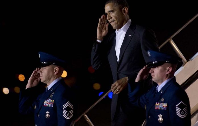 Obama told Hyde Park Academy students in their navy uniform shirts