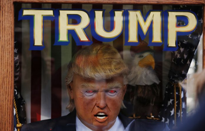 The likeness of Donald Trump stands inside of a themed fortune telling machine in Columbus Circle in New York