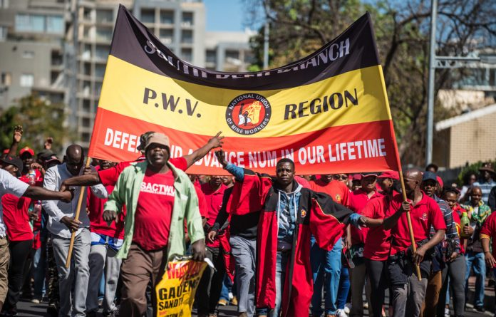 Scheduled speeches have been cancelled after rally organisers attempted unsuccessfully to restore calm among workers.